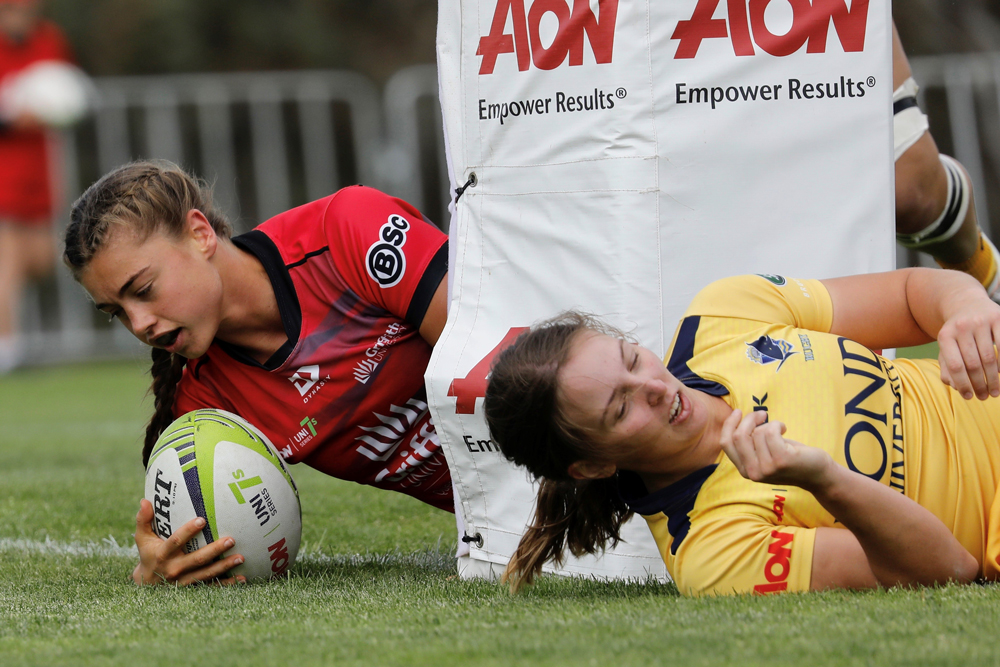Lily Dick scores for Griffith University. Photo: Karen Watson