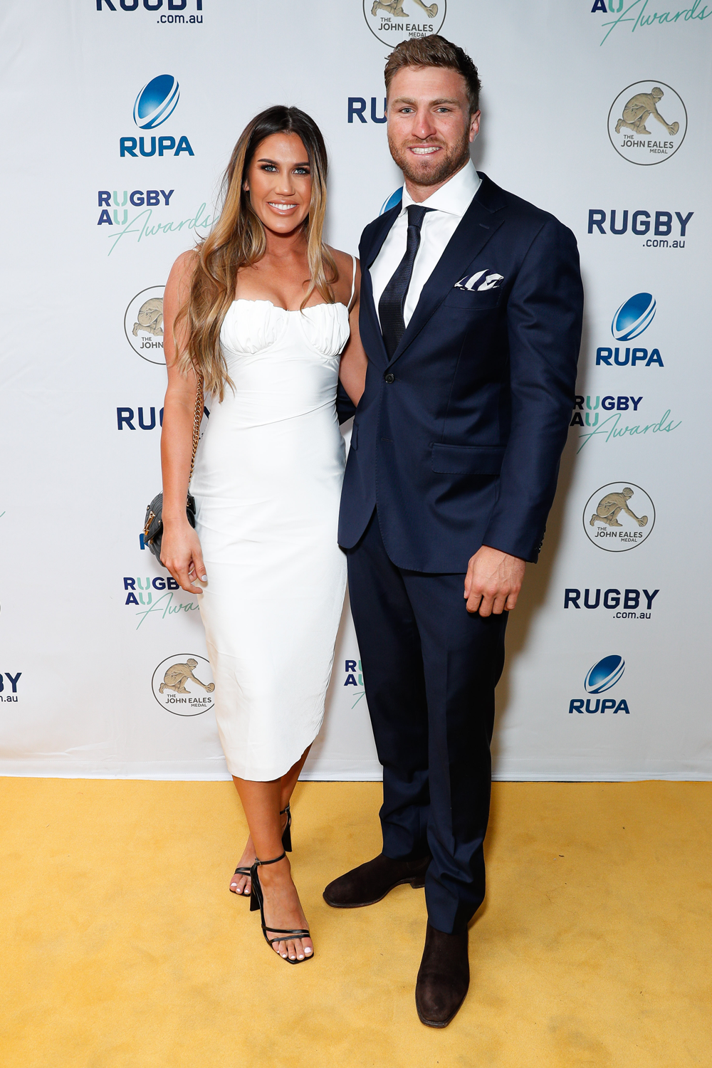 Sevens superstars Charlotte Caslick and Lewis Holland arrive at the Rugby Australia Awards. Photo: Getty Images
