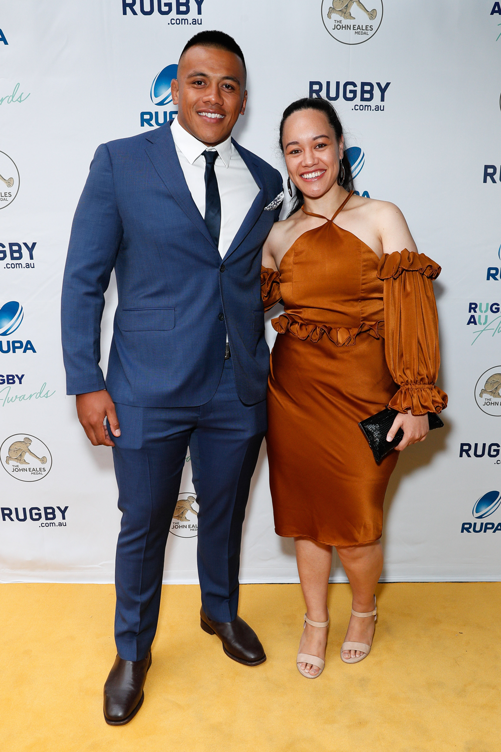 Allan Alaalatoa and his partner at the Rugby Australia Awards. Photo: Getty Images