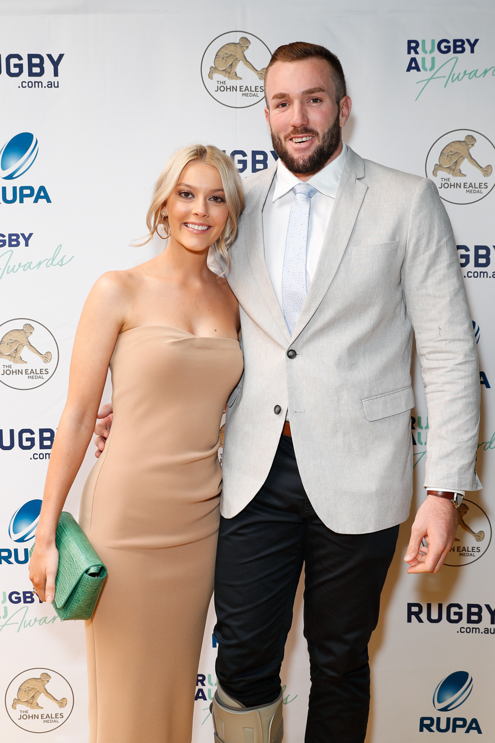 Izack Rodda and his partner arrive at the Rugby Australia Awards. Photo: Getty Images