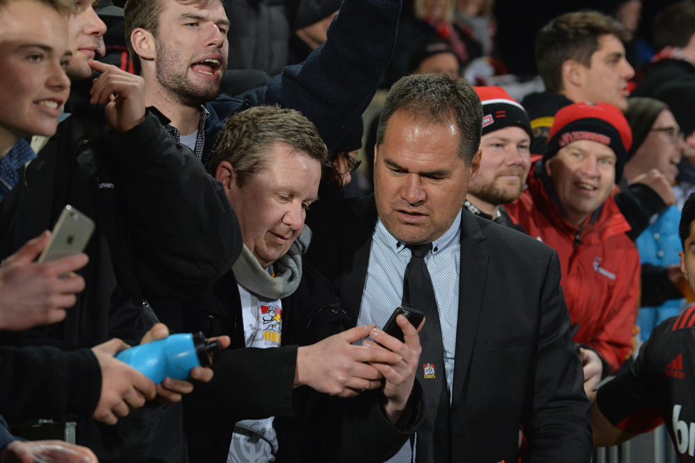 Dave Rennie speaks to a fan at a Chiefs game. Photo: Getty Images