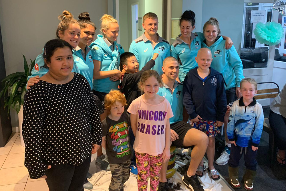 The Aussie Sevens teams visited Ronald McDonald House earlier this year. Photo: Supplied