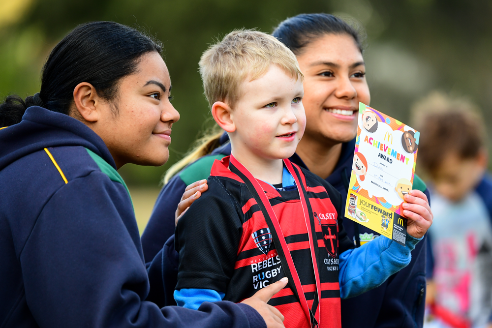 Junior coaches and senior women's players Lusia Samuelu and Alicia Pena-Tipene with their under 7 player of the day. Photo: Rugby AU Media/Stuart Walmsley