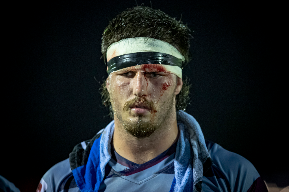 Liam Wright will have to find new ways to cover a cut he suffered in the Reds' preseason trial. Photo: QRU Media/Brendan Hertel