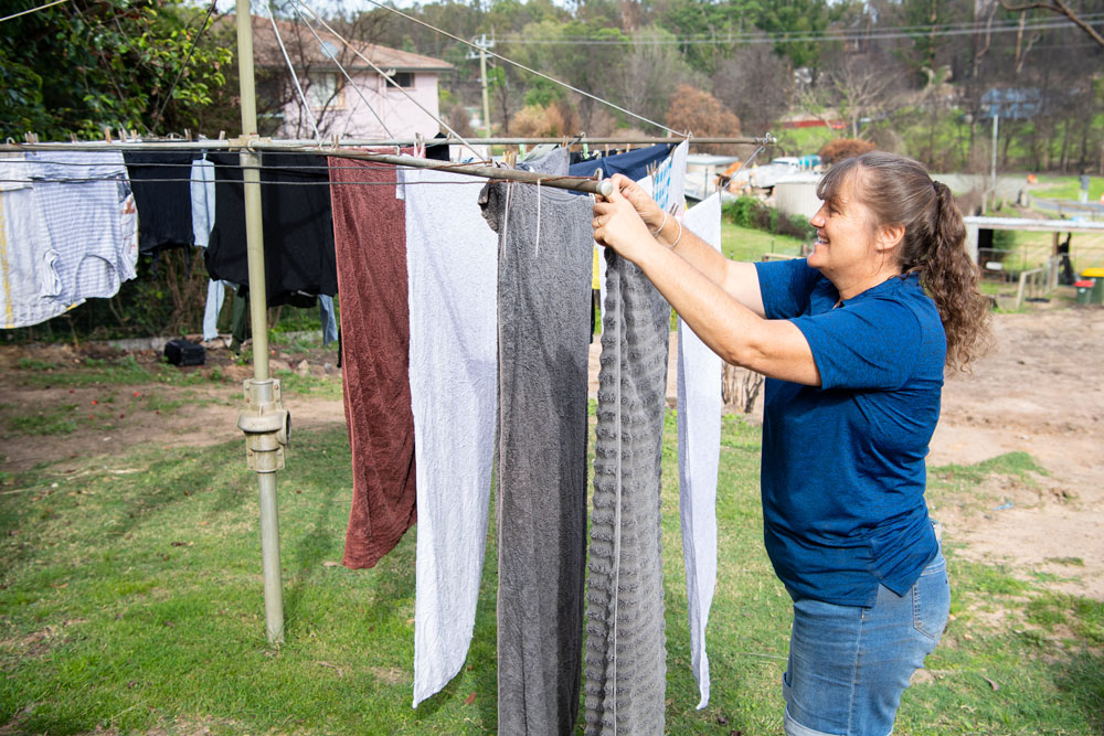 Jenny McGann hangs out the washing on her beloved hills hoist. Photo: Rugby AU Media/Stuart Walmsley