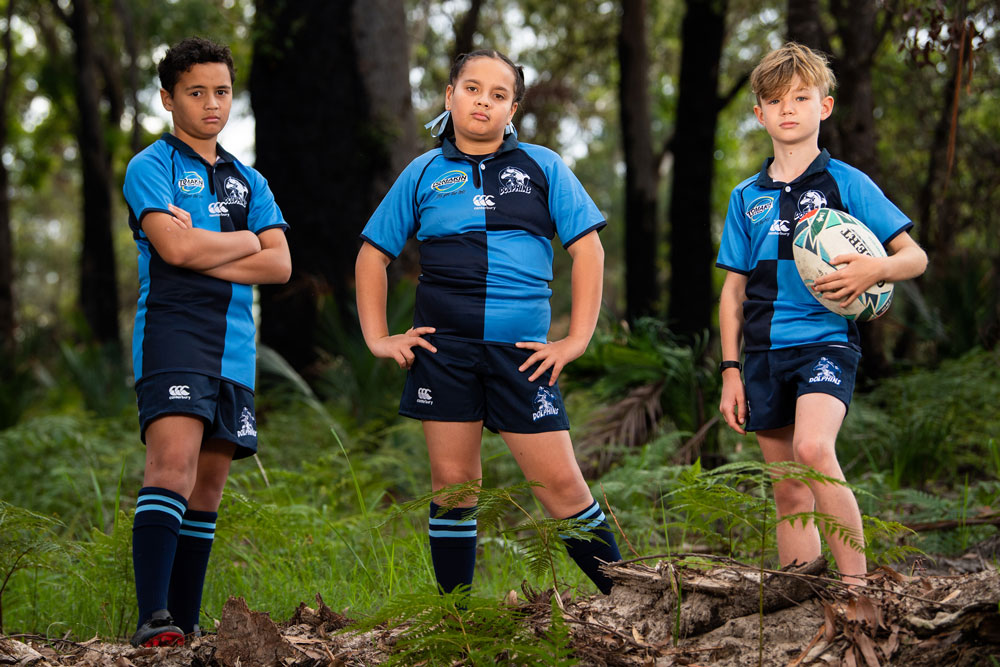 Dolphins junior Emily Katuke (centre) with a pose that sums up rugby's current predicament. Photo: Rugby AU Media/Stuart Walmsley