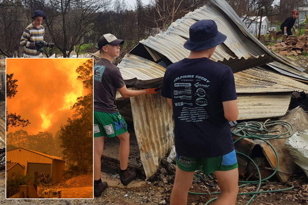 Broulee Dolphins help clear the McGanns' property in Mogo and (inset), the fire approaching on New Year's Eve. Photos: Supplied
