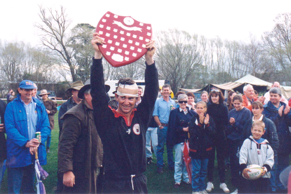 Redbacks captain Michael Toirkens celebrates the Far South Coast premiership at Braidwood Recreation Ground in 1997. Photo: Supplied