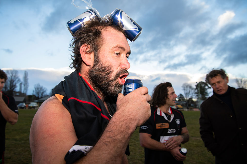 Braidwood's Nick Blackmore enjoys some post-match refreshment at The Rec Ground. Photo: Rugby AU Media/Stuart Walmsley