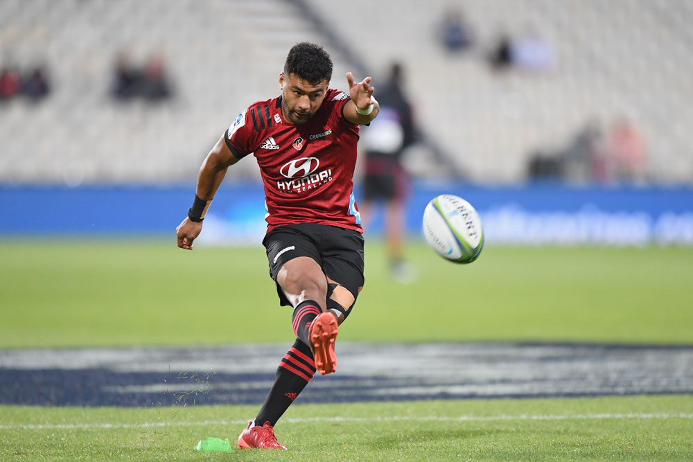 Richie Mo'unga says he instinctively picked up a rogue football and kicked it back to his teammates, in breach of lockdown regulations. Photo: Getty Images
