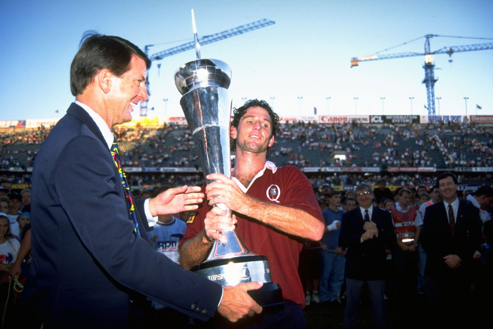 Queensland captain Peter Slattery holds up the 1994 Super 10 trophy. Photo: Getty Images